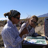 Kate and Cheyenne pressing plants. Photo by BLM NV030.