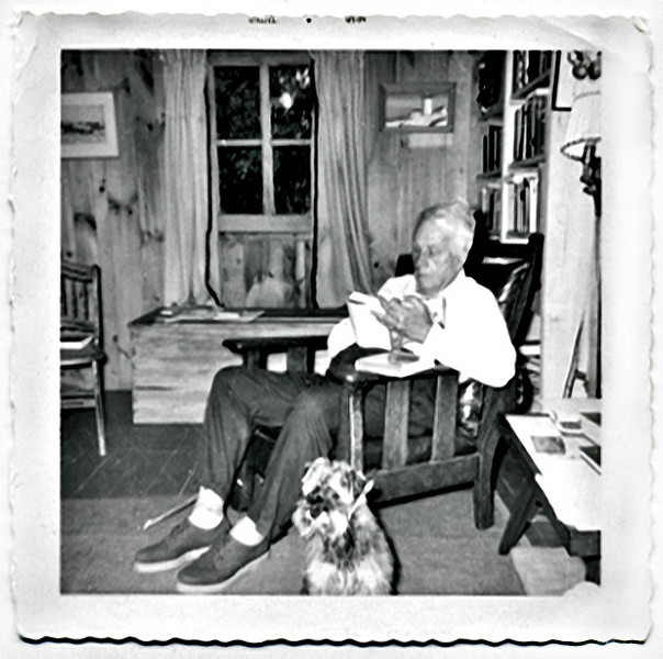 Robert Frost Reading in His Morris Chair at his Farm in Ripton, VT, 1960. Gelatin Silver Print Snapshot