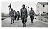 "US Invasion Forces, D-Day, Normandy, France. Gelatin Silver Print Snapshot. Hand written on verso: ""Art looking  very impressive and victorious - invasion-troop-ish."""