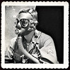 "Army Corporal Wearing Gas Mask, 1941. Gelatin Silver Print Snapshot. Handwritten on verso: ""This picture is not too good but you can see how we look when they say, Gas! Oct 1941 Gardner"""