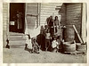 Black Family at Home, c. 1900. Early Gelatin Silver Print Mounted on Heavy Paper.