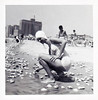 Gathering Shells at the Shore, c. 1950. Gelatin Silver Print Snapshot