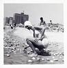 Gathering Shells at the Shore, c. 1950. Gelatin Silver Print Snapshot