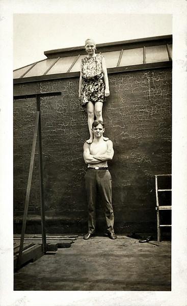 Gal Standing on Man's Shoulders, c. 1930s. Gelatin Silver Print Snapshot