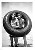 Two Guys in an Inner Tube at the Beach, c. 1940s. Gelatin Silver Print Snapshot