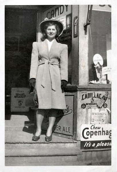 Woman in the Entrance to a Drugstore, c. 1930s. Gelatin Silver Print.