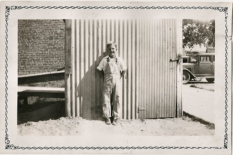 Boy at Back Side of Pop Corn Stand, c. 1930s. Gelatin Silver Print Snapshot