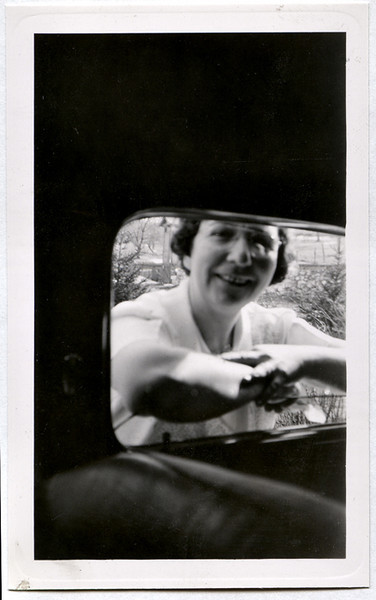 Woman Gossiping in Car Window, c. 1940. Gelatin Silver Print Snapshot