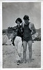 Couple at the Beach, She Bold, He Shy, c. 1920s. Gelatin Silver Print Snapshot
