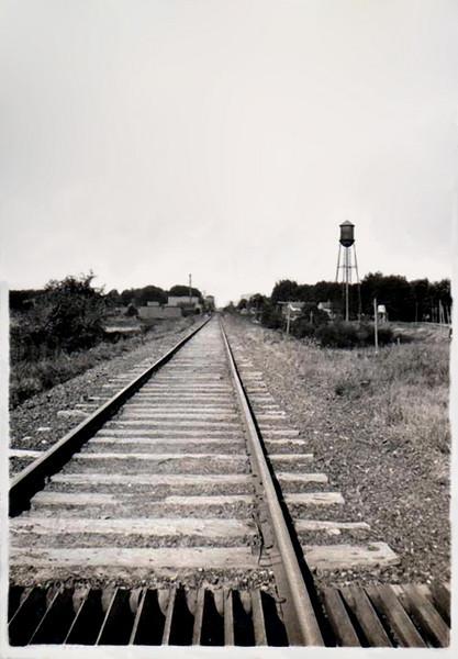 Train Tracks and Water Tower, Coopersville, MI, 1917. Gelatin Silver Print Snapshot