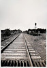Train Tracks and Water Tower, Coopersville, MI, 1917. Gelatin Silver Print Snapshot