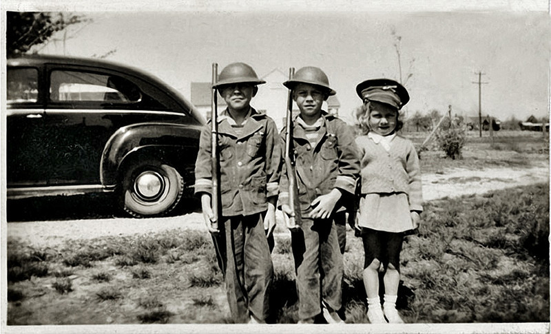 Three Children Playing Soldier, c. 1940s. Gelatin Silver Print