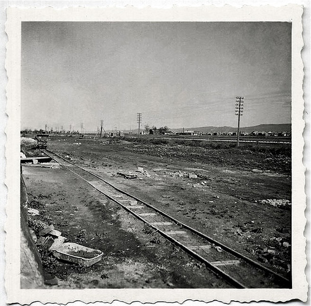 Along the Right-0f-Way: Abandoned Track at the Edge of a City, c. late 1940s. Gelatin Silver Print Snapshot