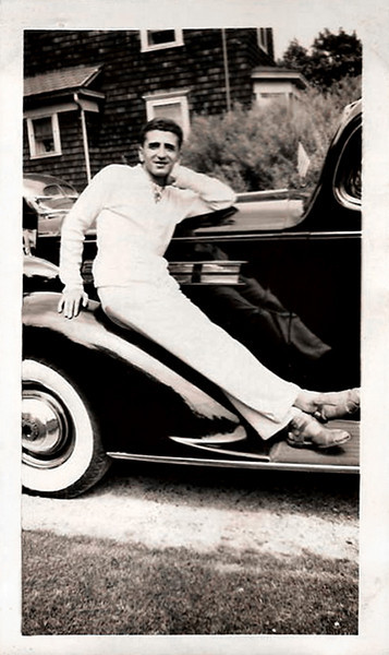 Man Lounging on Packard Fender, c. Early 1940s. Gelatin Silver Print Snapshot