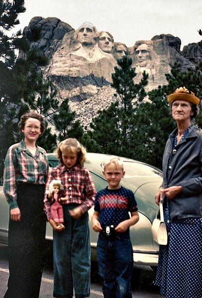 Family at Mount Rushmore with Nash Ambassador, c. 1950s. Kodachrome Color Print. (Note how the people are arranged in the same configuration as the monument.)