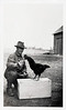 Farmer/Rooster Communication: Training a Champion, c. 1920s. Gelatin Silver Print Snapshot