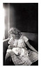 "Young Mother Breast Feeding, c. 1940s. Gelatin Silver Print Snapshot. On verso: ""Sharon Ruth Redding 1 month."""