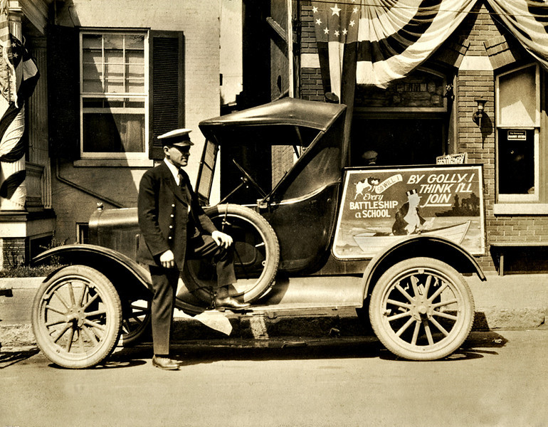 Navy Recruiter with Jiggs Poster on Flivver, c. 1918.  Gelatin Silver Print Snapshot