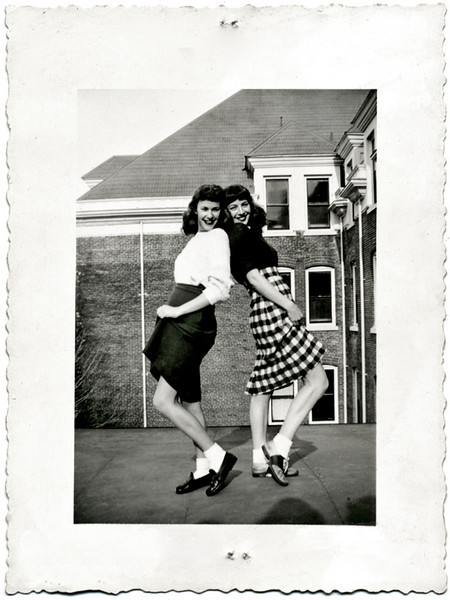 Two Teenage Sisters Vamping for the Camera, c. 1950s. Gelatin Silver Print Snapshot