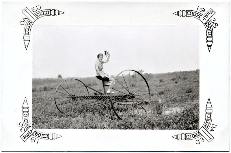 Girl Sitting on a Horse Drawn Hay Rake, 1938. Gelatin Silver Print Snapshot