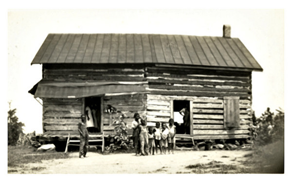 Sharecroppers in Two Family Shack, c. 1930s. Gelatin Silver Print Snapshot