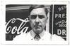 Man in Front of Drugstore, c. 1930s. Gelatin Silver Print Snapshot
