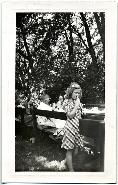 Girl Caught by the Camera Picking Her Nose at a Picnic, c. 1940s. Gelatin Silver Print Snapshot