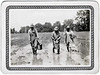 "Sharecroppers Planting Cotton, Seguin Texas, 1927. Gelatin Silver Print Snapshot.  Hand written on verso: ""Muddying in cotton seed 1927."""