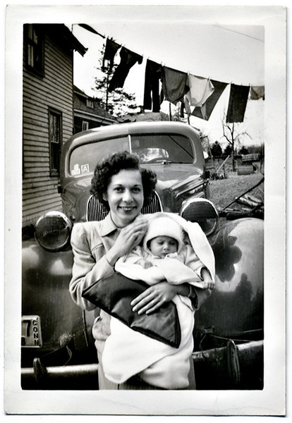 Mother and Infant Dressed for an Outing, CT,1943. Gelatin Silver Print Snapshot. (Notice the war-time black-out tape on the headlights.)