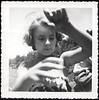 Young Girl Managing Her Fishing Line, c. 1949. Gelatin Silver Print Snapshot