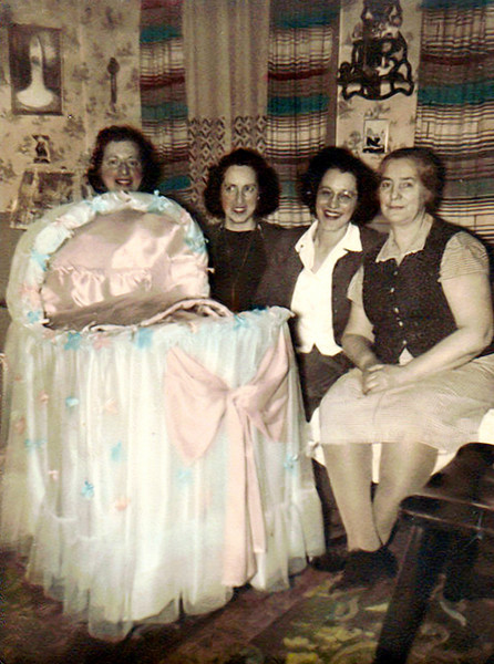 Women with Bassinet, c. 1945. Hand Colored Gelatin Silver Print.