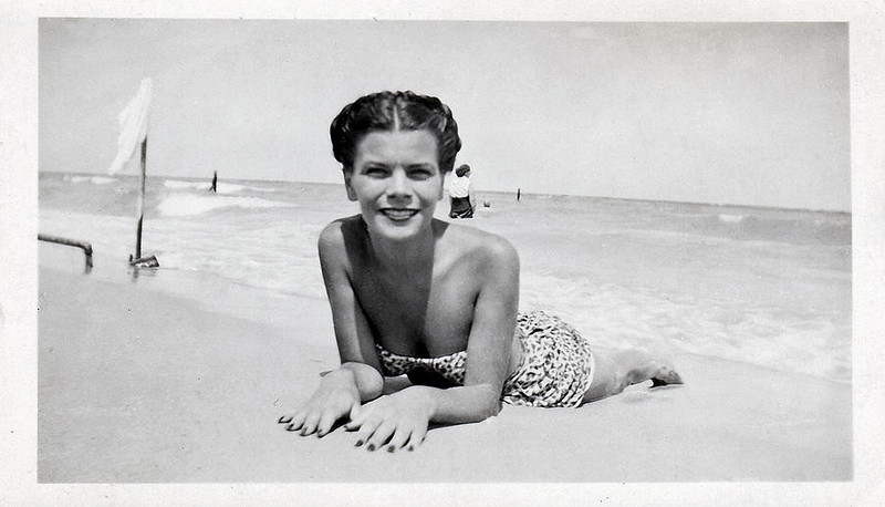 Woman at the Beach Lying in the Sand, c. 1940s. Gelatin Silver Print Snapshot