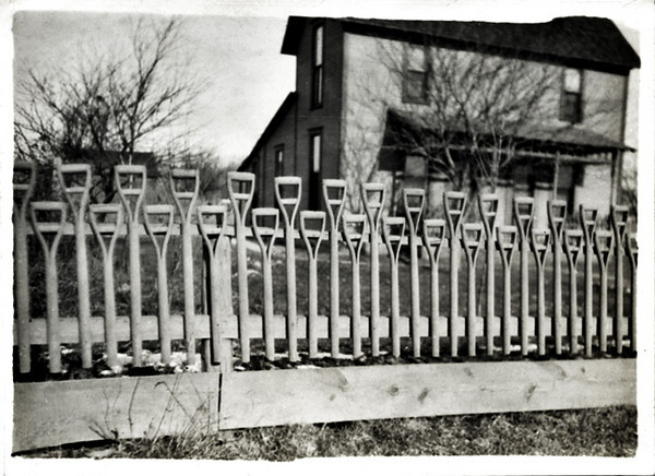 Fence Fashioned out of Shovel Handles, c. 1920s. Gelatin Silver Print Snapshot