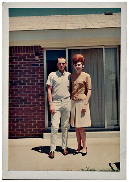 Couple Outside Motel Room, Red Head with Big Hair, c. 1960s. Dye Coupler Print Snapshot