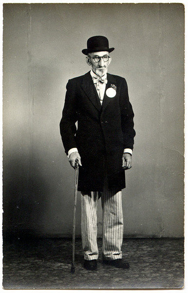 Man in Formal Attire and What Looks Like A False Nose, c. 1915. Real Photo Post Card