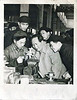 Chairman Mao with Students, c. 1940s. Gelatin Silver Print Snapshot. Chinese lettering on verso.