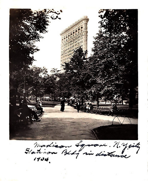 """Madison Square, N. Y. City Flatiron Bldg in distance 1904."" Gelatin Silver Print Snapshot. (Alfred Stieglitz's photograph of the Flatiron Building was published in Camera Work in 1903 and Eduard Steichen's in 1906.)"