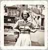 Young Black Woman in Back Yard, c. 1940s. 1940s. Gelatin Silver Print Snapshot.