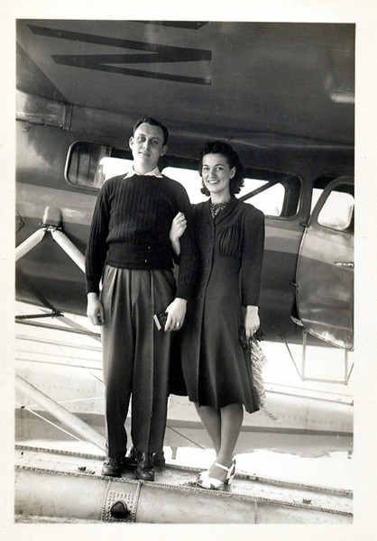 Couple on Pontoon of Seaplane, c. 1930s. Gelatin Silver Print Snapshot
