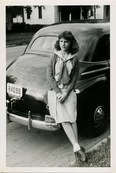 Young Woman Leaning on Fender of Car, c. 1940s. Gelatin Silver Print Snapshot