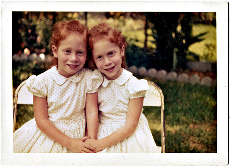 Identical Twin Red Headed Young Girls in the Back Yard, c. 1960s. Dye Coupler Print Snapshot