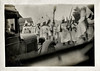 Ku Klux Klan Rally Crossing Street, c. 1920. Gelatin Silver Print Snapshot