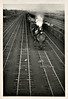 Freight Train from a Bridge, c. 1940s. Gelatin Silver Print Snapshot