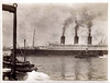 Ocean Liner and Tug Boats, c. 1910s. Gelatin Silver Print Snapshot