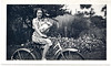 Girl with Baby on Bicycle, c. 1940s. Gelatin Silver Print Snapshot