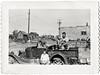 "Family Posing in Derelict Pick-up Truck, c. 1930s. Gelatin Silver Print Snapshot. Hand written on verso, ""Love Tommy, Myrna, Leroy,Tim, Cim, Steve"""