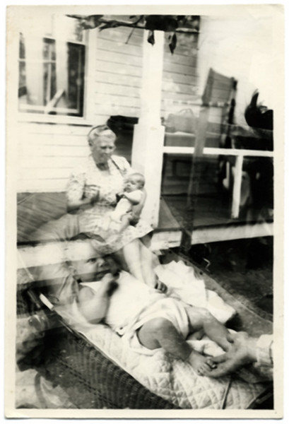 Grandma with Infant Double Exposure, c. 1940. Gelatin Silver Print Snapshot.