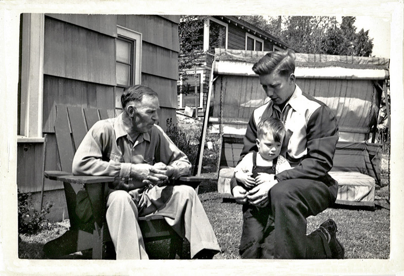 """Three Generations, Manchester, WA, 1943. Gelatin Silver Print Snapshot. Hand written on verso: """"3 Generations: Wm Paul Kingston (Grandfather), Kenneth Paul Kingston (Father), Rodger Paul Kingston (Son) 1942 near Seattle, Washington"""" (The son was me; I was two years old.)"""