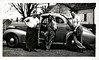 3 Men Gathered Around a Coupe, c. 1940s. Gelatin Silver Print Snapshot