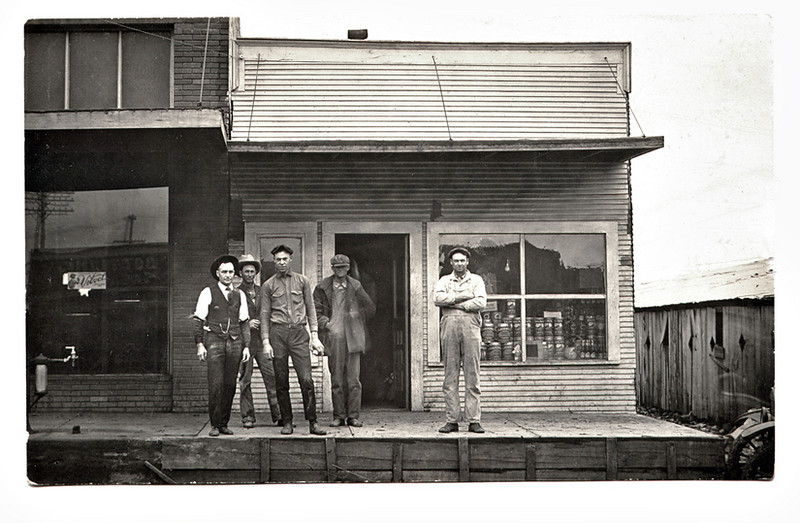 Western Storefronts with Locals Posing, c. 1916. Real Photo Post Card